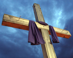 FILE PHOTO OF CROSS DRAPED IN PURPLE OUTSIDE CHURCH DURING LENT